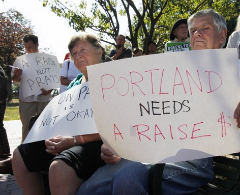 Elden McKeen, right, and his wife, Pat, left, listen to speakers at Monday's Labor Day rally in Portland. Joel Page/PPH Staff Photographer